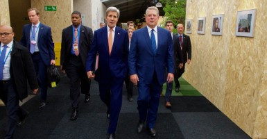 U.S. Secretary of State John Kerry with former Vice President Al Gore at the Paris Climate Conference. (Photo: State Department/Sipa USA/Newscom)