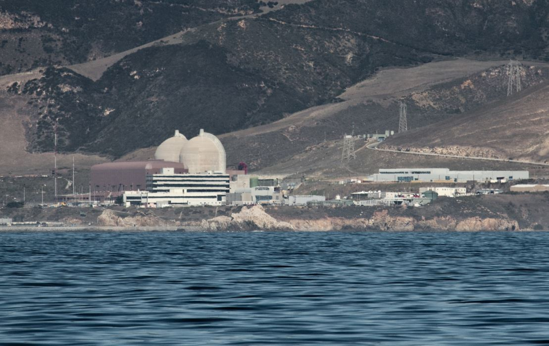 "More details Diablo Canyon Power Plant, 2009 photo from offshore. The light beige domes are the containment structures for Unit 1 and 2 reactors. The brown building is the turbine building where electricity is generated and sent to the grid. In the foreground is the Administration Building (black and white stripes). Picture:  ""Mike"" Michael L. Baird via Wikimedia"