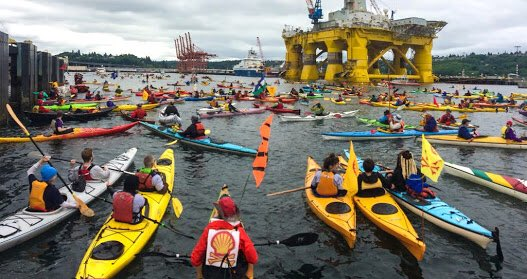 Kayaktivists protesting against oil exploration in kayaks made of oil