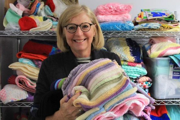 PHOTO- Knit One Give One founder Ros Rogers at their sorting centre in Caulfield. (ABC News- Nicole Mills)